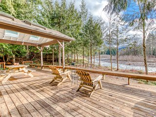 Riverfront home w/ spacious deck, private hot tub, shared pool & sauna- dogs OK!