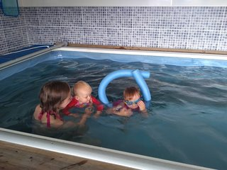 Our grandchildren learning to swim in the pool