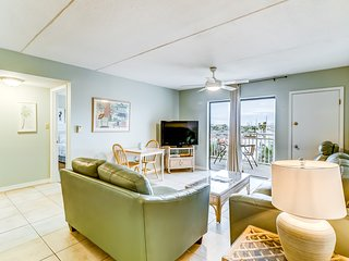 Beach view condo w/ a spacious living area, shared pools, & tennis courts!