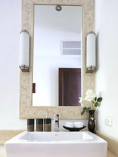 Counter top sink with travertine tiles & marble tops