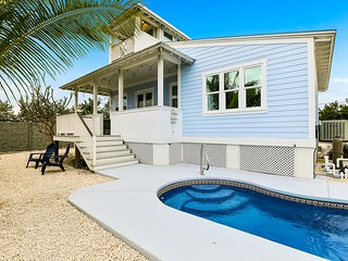 Key West style waterfront home w/ private pool, modern decor and prime location!