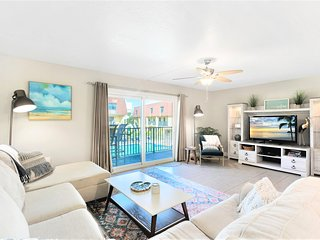 Relax in this huge living room, complete with a comfy wraparound couch, huge entertainment center and a view over the pool!