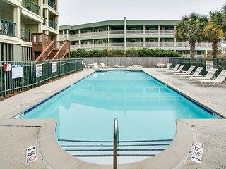 Beachfront villa w/ ocean views, private deck, pool access – steps from beach!