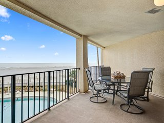 Charming beachfront condo w/beach access, shared pool, and great water views!