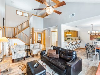 Welcoming townhome w/ a wood-burning fireplace, furnished deck, & gas grill