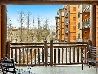 Polished downtown condo w/ fireplace & shared pool/hot tub/fitness room!