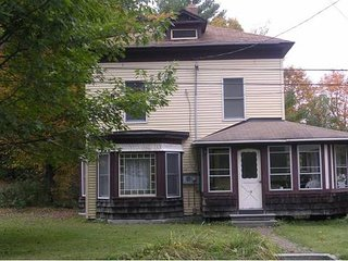 Beautiful Colonial house near VAST trail and just a short walk to downtown .