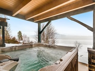 Lakefront home w/ private beach, hot tub, amazing views & sun room!