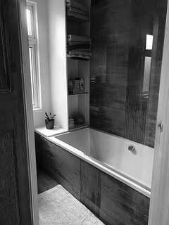 Family bathroom with bath & shower on the first floor