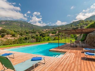 Villa Es Port with pool, garden and panoramic sea and mountain views