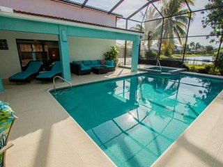 Newly listed! Covered Lanai w/360 degree rotating TV-Heated Pool/Spa w/lake view