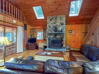 Lakefront cabin w/ wood burning fireplace, private dock, firepit, & water views!