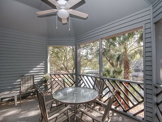 Lagoon view, second floor villa w/ screened in porch, short walk to the beach!