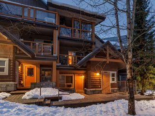 BRAND new listing - Glacier Reach beauty with private HOT TUB, across the street