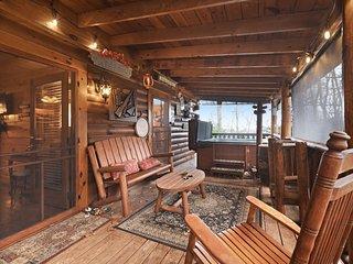 Dog-friendly, woodland cabin w/ a hot tub, firepit, air hockey, & a porch swing