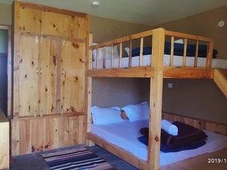 Family Bunk Bed Room In Traditional Wooden Cottage set in Apple Orchard