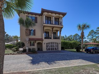 Classy home with shared pool, balconies, golf cart, and private gas grill!