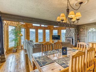 Deluxe cabin w/ mountain views, private hot tub, & wood-burning fireplace!