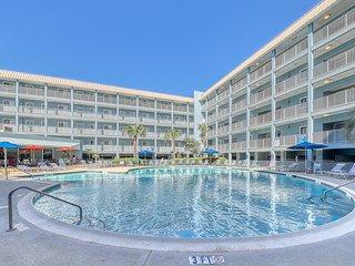 Bright island condo w/ shared pool & central location!