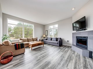 Polished beach house w/ ocean views, private grill, free WiFi - steps to beach!