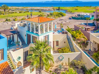 Vibrant house w/ ocean and golf course views, shared pool, private gas grill