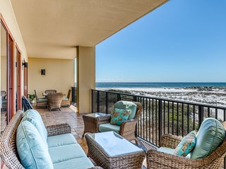 Luxurious beachfront condo with shared pool, private balcony, & wet bar!