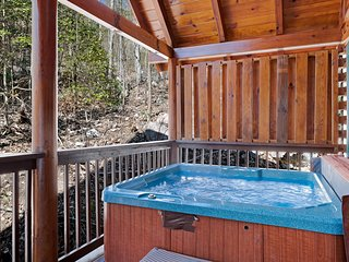 Tranquil woodland cabin w/ free WiFi, a private hot tub, & a shared pool
