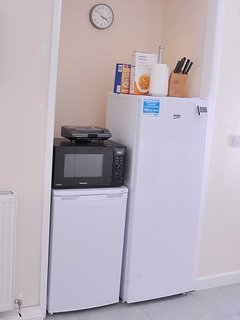 Large refrigerator, freezer, microwave and breakfast cereals