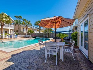 NEW LISTING Four Bedroom home Near Beach Access! Shared Pool! Across from Rick S