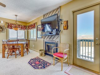 Cozy family friendly condo with mountain view, hot tub, and indoor pool.