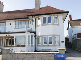 SEASCAPE beachfront with sea views, enclosed lawned garden, off road parking