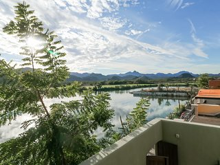 Lakefront apartment w/lake & golf views from the terrace, and three shared pools