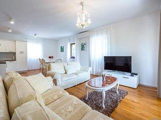 Comodo e spazioso appartamento Piana per gruppi e famiglie, vicino alla spiaggia