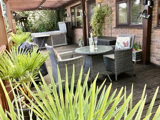 Ground floor Apartment with covered decked area, hot tub and lovely garden.