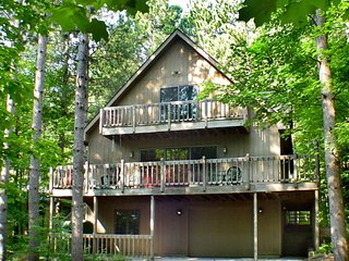 Stunning two-story home in the trees w/ a firpit, furnished deck, & balcony!