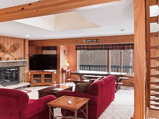 Mountain condo w/ a private gas grill, wood-burning fireplace, & mountain views!