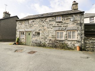 TREFLYS BACH, stone-built, detached cottage, multi-fuel stove, pet-friendly, in