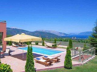 Fab sea views, lovely gardens- smart modern villa
