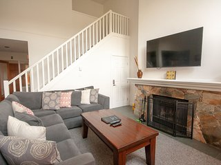Living area w/ sofa bed, cable TV and wood-burning fireplace