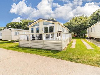 Luxury lodge for hire at Broadland sands holiday park with decking ref 20349BS