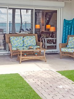 Ocean lanai with large sliding glass patio doors for indoor/outdoor living.