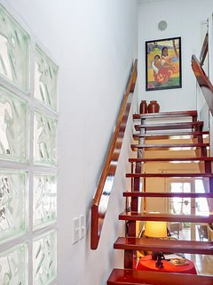 Stairway to two upstairs bedrooms and baths.