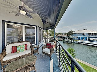 Beautiful 2,594 Square Foot Canal Home with Private Pool, Dock & Sandy Beach