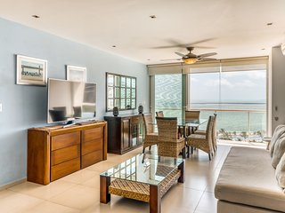 Ocean view apartment w/ shared pool,  grill,  playground, & beach access