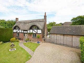 Picture Book Thatched Cottage in delightful secluded gardens . Parking