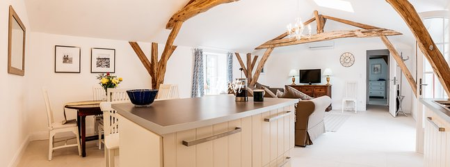 The open plan salon, kitchen and dining area