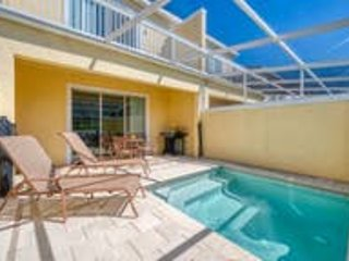 Private pool area with lounge chairs and card table on the lanai.