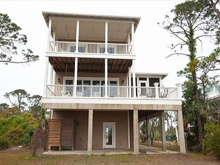 Beautiful bay front home on private road. Decorated with attention to detail
