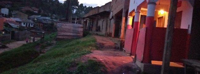 The front face of the home stay is in white and red with beautiful colors of lights in orange.