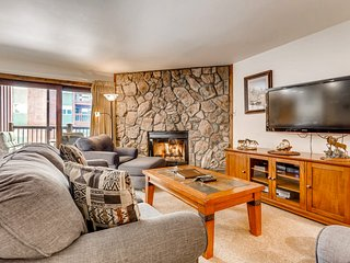 Rustic mountain condo close to town w/ private balcony & shared hot tub & pool